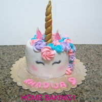 Unicorn chocolate cake covered in fondant and decorated with buttercream horn made of gumpaste