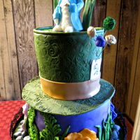 Alice In Wonderland 2 tier cake covered in fondant with gum paste White Rabbit