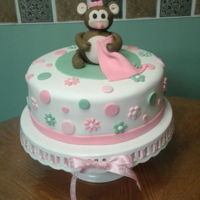 Baby Monkey Shower Cake All fondant and the monkey was shapped using 50/50 fondant and gumpaste.