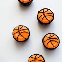 Basketball Cupcakes basketball cupcakes - chocolate cupcakes covered with cream cheese frosting