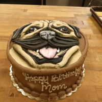 "Buttercream Pug Cake 8"" round double layer cake decorated with buttercream."