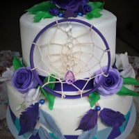 Dream Catcher Cake Two tiered dream catcher cake with fondant roses and feathers.
