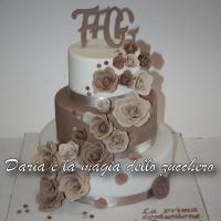 First Communion Cake With Roses a cascade of roses in gum pastas in soft colors for the first communion of Fracesco