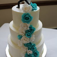 "Gumpaste Rose Cascade In Turquoise And White This cake was a 6, 8, 10 inch tiers done in Swiss Meringue Buttercream with a cascade of Gum paste Roses from my Etsy Shop ""..."