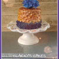 Hammered Copper Hammered effect, with bubble bead mould border. Topped with purple and blue clay craft clay hydrangeas.