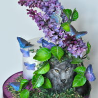 Lilacs And Wolf My contribution to the World Lupus Day Sugar Art Collaboration. Red velvet cake with cream cheese frosting, gum paste lilacs and leaves,...