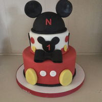 Mickey Mouse Cake Mickey Mouse cake for grandchild's first birthday.