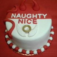 Naughty Or Nice All fondant cake. Painted the halo with gold edible paint. Used a mold for the wings.