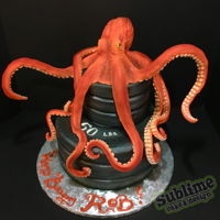 One Jacked Cephalopod This octopus cake is for a gym rat who loves sea life! He is sculpted in modeling chocolate, with a two tier cake iced in buttercream for...