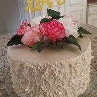 Personal Shower Cake Vanilla pound cake, textured buttercream, real flowers.