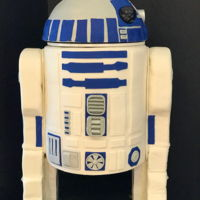 R2D2 Star Wars Cake R2D2 body is all cake, arms (or are they legs?) are rice crispy treats, and the head is a custom fiber glass dome fitted with electronics...