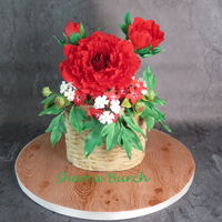 Red Peony In Raffia Basket. red gumpaste peonies and flowers in a modeling chocolate/fondant raffia basket on wood look cakeboard.