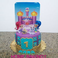 Shimmer & Shine chocolate cake covered in fondant. toppers are paper prints