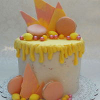 Strawberry Lemonade Tall six inch round in buttercream with White Chocolate ganache, Strawberry/Lemon chocolate shards, Sixlets, Lemon Heads, Lemon Drops, and...