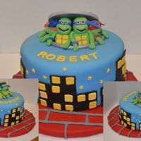 Teenage Mutant Ninja Turtle Cake All fondant and used a mold to make the sewer lid. Made this for my grandson's birthday and he loved it. Stole the design from a few...