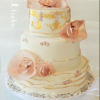Weddingcake With Goldleaf And Ruffles lovely weddingcake, with ruffles, and some fantasy waferpaper flowers, painted the underboard to match the weddingdress.