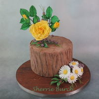 Yellow Rose, White Daisies On Stump Mbalaska yellow roses & buds, with white Shasta daisies on wood stump with wood look board.