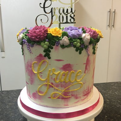 Floral Graduation Cake I love that you can now take any cake style, put in a pretty pick and it's ready for any occasion! This cake is vanilla with smb...