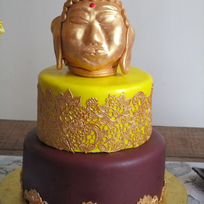 Kathleen's 60Th Buddha Cake I made the topper out of Rice Krispie Treats, covered in ivory fondant & painted with Aztec gold luster dust mixed with Everclear. Top...