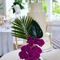 A Palm Of Orchids A Miami Beach inspired wedding cake. 5 tiers (including a double barrel) with fresh orchids and palm leaves.