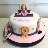 "Kate's Gymnast Cake 10 "" Chocolate biscuit cake covered with fondant. Gymnasts and equipment are made with modelling paste"