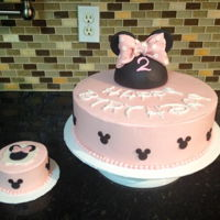 Minnie Mouse Pink Swiss Meringue Butterceam cake with fondant Minnie Mouse ears topper