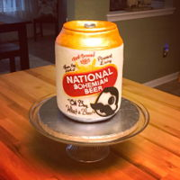 Natty Boh Beer Can Cake Chocolate and vanilla cake with Italian meringue buttercream.