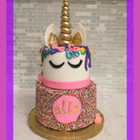 Unicorn Sprinkle Cake 8/6 inch unicorn cake. bottom covered in buttercream/sprinkles top fondant