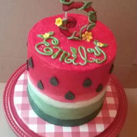 Watermelon Theme Birthday Cake 4-tiers of red velvet cake with mini chocolate chips inside. Buttercream smoothed watercolor technique. Fondant decor.