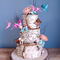 Whimsical Hummingbird Birch Cake I loved recreating this cake. It is my favorite wedding cake so far! The all flowers were made using renshaw gumpaste The hummingbirds were...