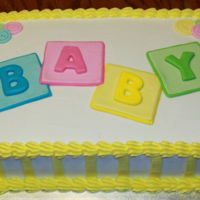 Baby Shower Sheet Cake Buttercream cake with MMF buttons and decorations.
