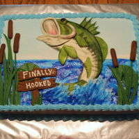 Bass Fishing Grooms Cake 9x13 cake iced with buttercream and decorated with MMF. Bass was hand molded with MMF then hand painted.