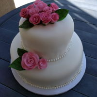 "Bridal Shower Cake Rose Theme Two tiers of lemon cake with vanilla bean smbc filling. Covered in fondant and boarders of sugar beads. Homemade roses using ""easiest..."