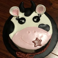 Cow Cake Buttercream frosting, fondant decorations.