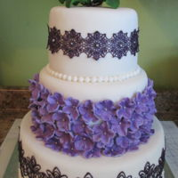 Dennise & Steven's Wedding Cake The bride loved purple! I was using pearlized cake lace mix & was having the worse problems with it not coming out nice. After about 4...