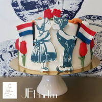Dutch Cake; Becoming The Dutch Nationality small cake to party that this woman became the dutch nationalily.all dutch features, tulips, kissing farmerscouple, the durch flag, the...