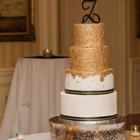 Elegant Gold Sequin Wedding Cake Four tier wedding cake covered with edible gold sequins and finished with black accents for an beautiful country club wedding. Hope you...