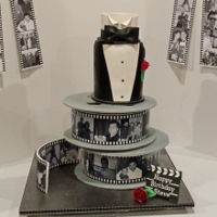 "Film Reel Birthday Cake Birthday Cake for a wonderful friend with a career in the TV film/video industry. Film reels are 10"" round / 4"" tall cakes with..."