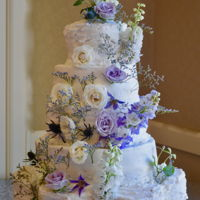 Five Tiered Floral Wedding Cake Five tiered cake with Swiss Meringue butter cream icing and fresh flowers. The bottom tier is made from seven 6' cakes. Thanks for...