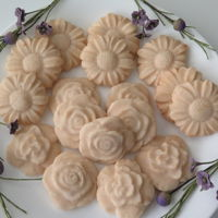 Flower Sugar Cookies Made With Silicone Molds firm sugar cookie dough pressed into silicone molds, baked, coated with a thin sugar icing glaze.