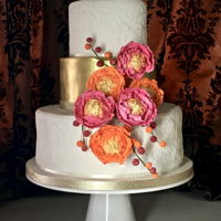 Gold And Embossed Tiers Wedding Cake With Bright Peonies Gold and Embossed Tiers Wedding cake with bright peonies