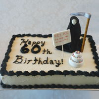 Grim Reaper Cake Nine by Thirteen Quarter Sheet cake in buttercream with fondant decorations.