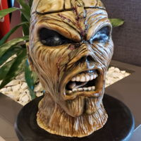 Iron Maiden Eddie Cake I made this for my cousins groom cake for a surprise. I live in Florida and made this in the condo in California with very limited supplies...