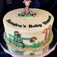 Little Giraffe Baby Shower Cake Buttercream cake with hand made fondant decorations.I used a Katy Sue mold for the giraffe ( just rounded the legs and built up the back...