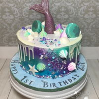 Mermaid Themed First Birthday This was my first mermaid cake. It was also my first attempt at making meringues and a drippy cake. I used candy clay for the mermaid tail...