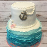 Nautical Birthday Cake Two tier cake with ombre ruffles, rope and shell accents, and gold painted anchor