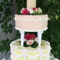Over-Piped Wedding Cake Twelve inch round and Ten inch hexagon in Cream Cheese icing with Royal icing piping and fresh flowers.