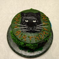 Panther Cake For Tim 2018 Dark Chocolate Mud Cake with Dark Chocolate Ganache. All Vanilla Buttercream decorating except for Pastillage whiskers. (I think these are...