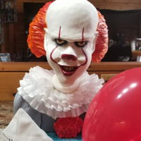 Pennywise I made this cake for my son's 22nd birthday. Pennywise has an egg-shaped rice cereal treat base attached to PVC pipe with a 50/50 mix...