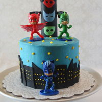 Pj Masks Six inch round in buttercream with fondant accents and souvenir PJ Masks.